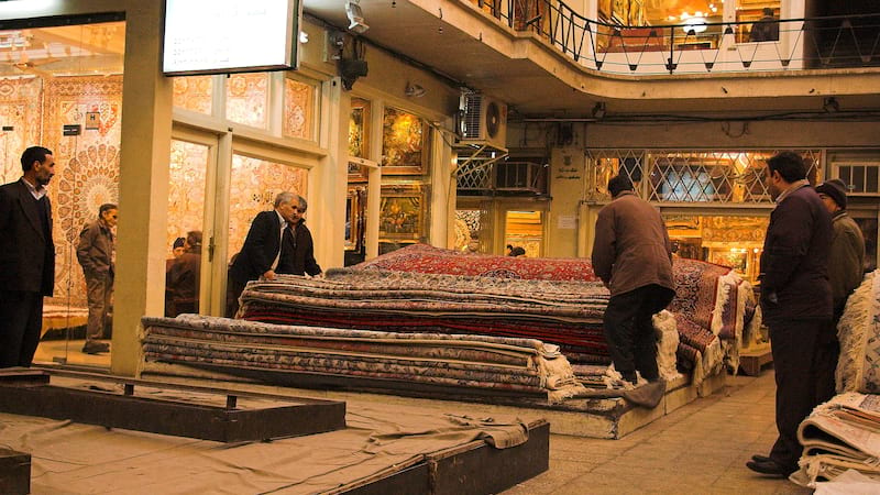 carpet bazaar in old tehran with different carpet in color