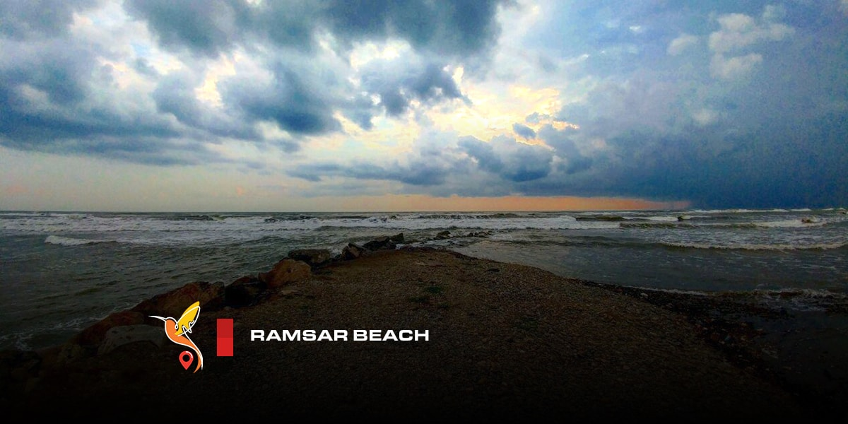 Ramsar beach under the clouds in the sky