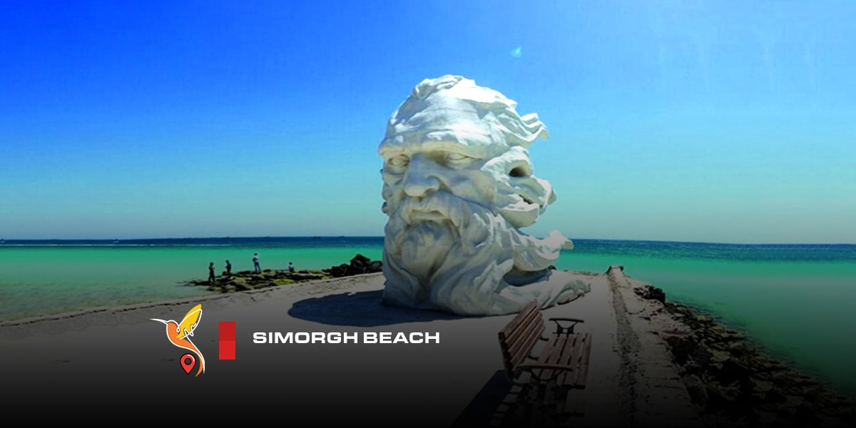 simorgh beach in kish island with an unique statue