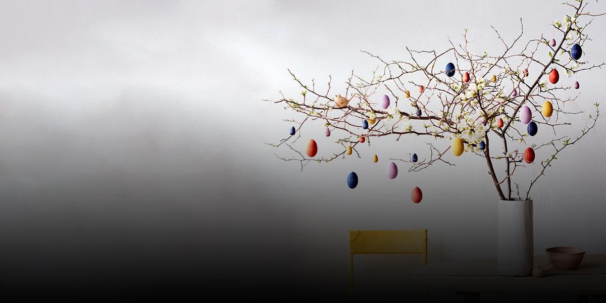 Using Nowruz eggs as tree ornaments)-min