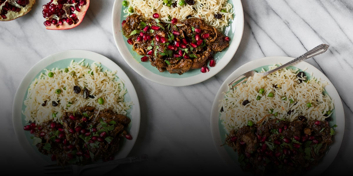Fesenjoon over persian rice with salad